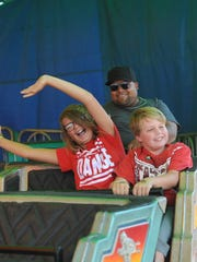 Austin Action and Taylor Brady, of Searsboro, go on a ride at the Iowa State Fair on Aug. 19.