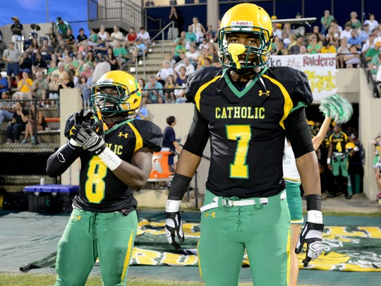 Catholic High School's   and Antione Barker No. 7)