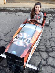 Hope Sandor, 14 of North Salem sits in the SoapBox