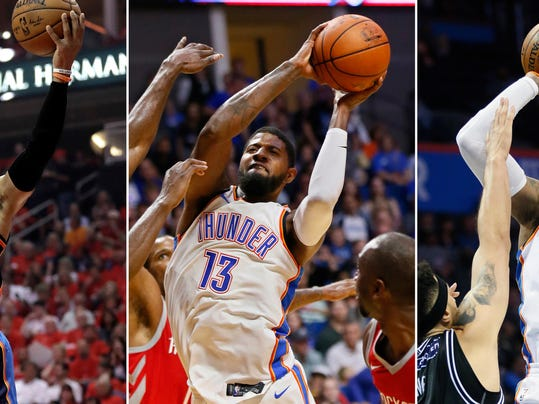 FILE - At left, in an April 25, 2017, file photo, Oklahoma City Thunder's Russell Westbrook (0) goes up for a shot against the Houston Rockets during the first half in Game 5 of an NBA basketball first-round playoff series, in Houston. At center, in an Oct. 3, 2017, file photo, Oklahoma City Thunder forward Paul George (13) shoots between Houston Rockets defenders during the third quarter of an NBA preseason basketball game in Tulsa, Okla. At right, in an Oct. 8, 2017, file photo, Oklahoma City Thunder forward Carmelo Anthony (7) shoots over Melbourne United center Josh Boone (3) in the third quarter of an NBA exhibition basketball game in Oklahoma City. Westbrook is a two-time scoring champion, two-time All-Star MVP and the reigning league MVP. Anthony is a 10-time All-Star and three-time Olympic gold medalist. George is a four-time All-Star, former Most Improved Player and an Olympic gold medalist. None of the new Oklahoma City Thunder teammates have an NBA title. (AP Photo/File)