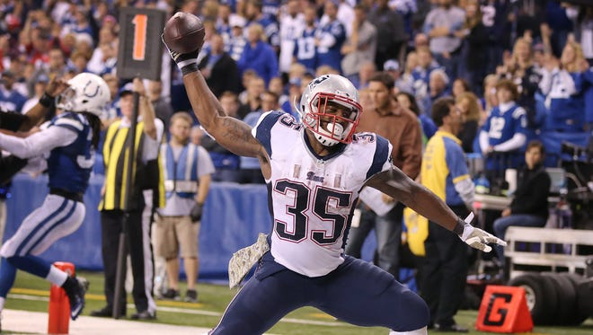 New England Patriots running back Jonas Gray celebrates his fourth touchdown with a spike against the Colts. Indianapolis hosted New England at Lucas Oil Stadium on Sunday, November 16, 2014.