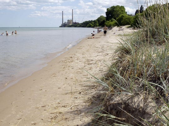 The sandy beach is a little smaller near King Park due to high water levels.
