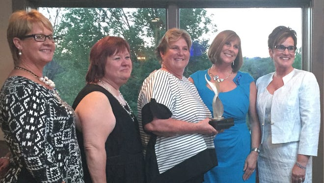 Nominees for the 2015 Athena Leadership Award included, from left, Rachel Hughes, Karen Clark, winner Jackie Carberry, Mary Walker and Valerie Ray.