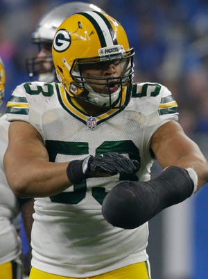 Green Bay Packers outside linebacker Nick Perry celebrates his sack of Detroit Lions quarterback Matthew Stafford.