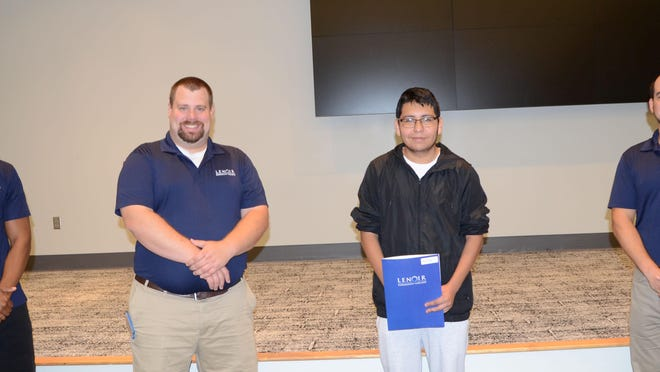 Pictured left to right are Don Donaldson, Student Success Coach, Matthew Berg, Director of the Aerospace & Advanced Manufacturing Center, North Lenoir High School student Alan Velaquez of Kinston, and Stephen Edwards, Industrial Systems Program Chair.