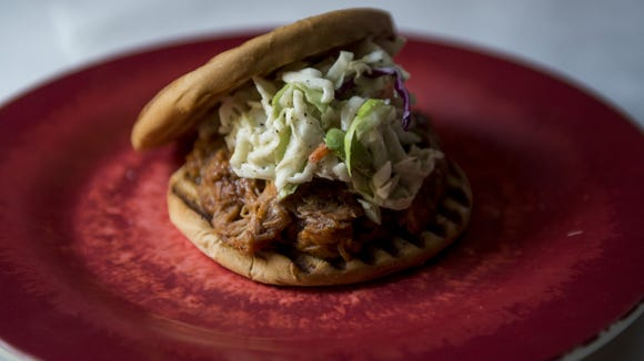 The boss pulled pork sandwich is one of the new Artmosphere