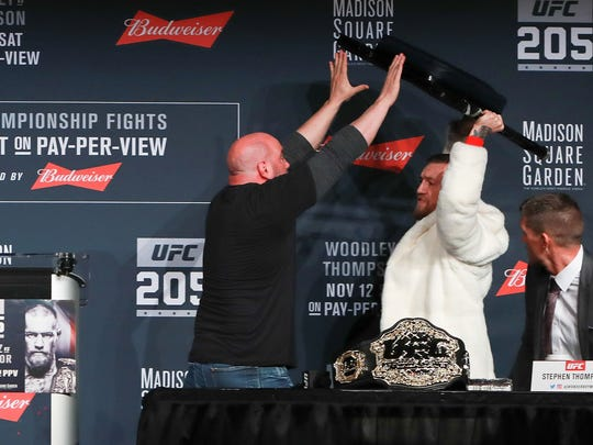 UFC president Dana White stops Conor McGregor from throwing a chair at Eddie Alvarez during the UFC 205 news conference at The Theater at Madison Square Garden on Thursday.