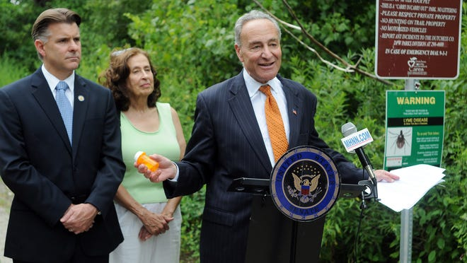Sen. Charles Schumer urges the FDA to address a shortage of doxycycline, an antibiotic used in treating Lyme. With him Tuesday in LaGrange were state Sen. Terry Gipson, left, and Jill Auerbach of Hudson Valley Lyme Disease Association.