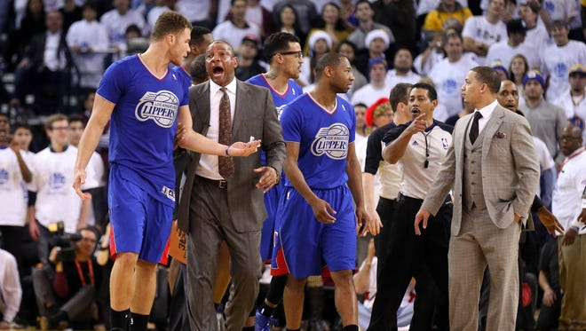 The Clippers, including coach Doc Rivers, were stunned by Blake Griffin (left) being ejected.