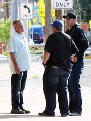 Men stand outside a union hall Tuesday at 730 E. Yandell