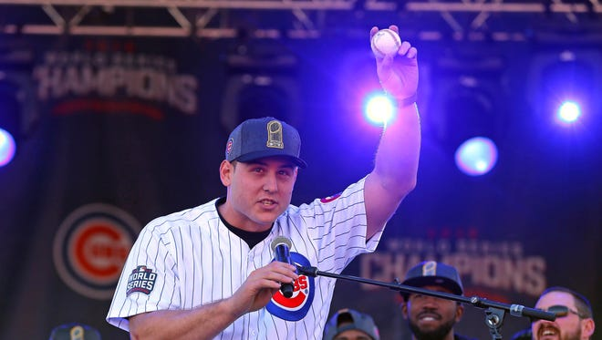Cubs first baseman Anthony Rizzo (44) holds the ball from the final out of game 7 during the World Series victory rally in Grant Park.