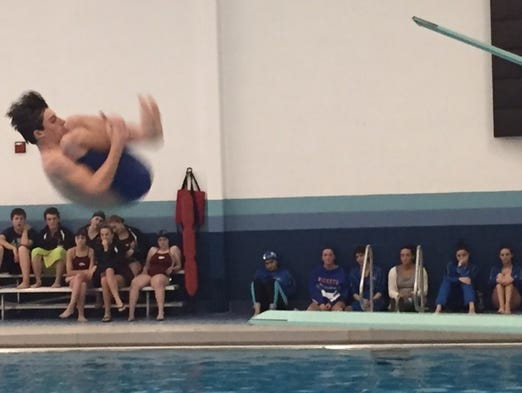 Spring Grove's Cole Roberts executes a dive in a meet