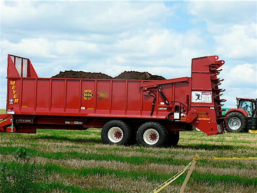 Big 700 to 900 bushel spreaders are used today.