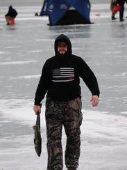 Pat DeStefanis carries an Atlantic salmon weighing