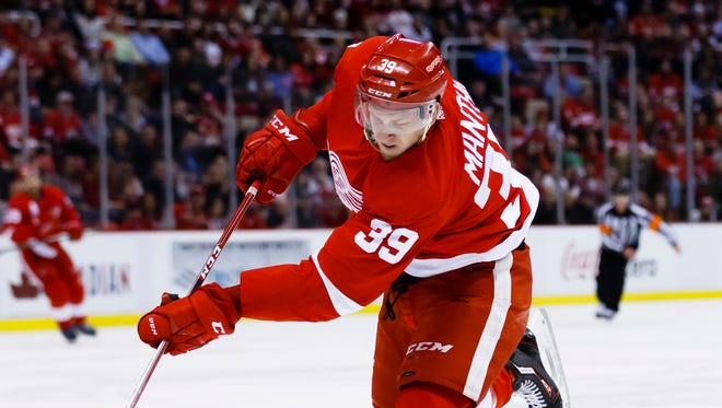 Red Wings right wing Anthony Mantha (39) shoots the puck as Canadiens defenseman Andrei Markov (79) defends in the first period of the Wings' 4-3 win Thursday at Joe Louis Arena.