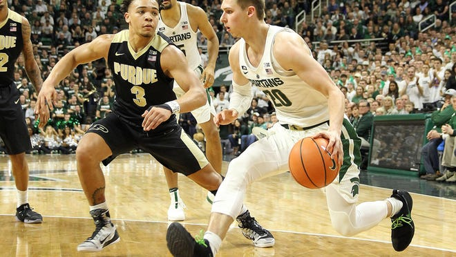 Michigan State's Matt McQuaid, right, will take his turn defending Purdue's Carsen Edwards, left. Edwards is averaging 25.5 points per game for the Boilermakers.