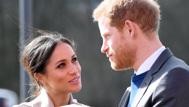 Prince Harry and Meghan Markle on March 23, 2018, in a pre-wedding visit to Northern Ireland.