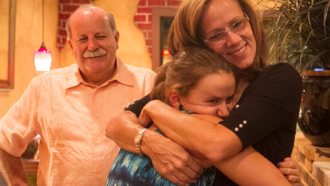 Chris Patricca celebrates with her daughter Patti after winning the District 3 School Board seat on Tuesday night.
