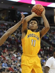Moeller's Miles McBride shoots the ball.