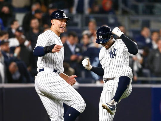 New York Yankees right fielder Aaron Judge (99) and New York Yankees shortstop Didi Gregorius (18) celebrate after scoring in the fifth inning against the Minnesota Twins at Yankee Stadium.