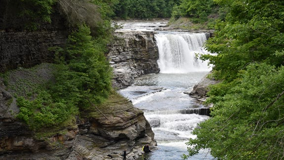 New York State Park Police and New York Police continued to search the pools below Letchworth's Lower Falls for the body of a missing boy swept over the cascade on Saturday.