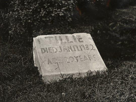 SEPTEMBER 17, 1972: A simple sandstone marker in front