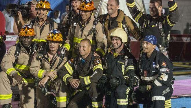 The Montgomery Fire Department's Blue Team, which broke the world-record with a time of 1:05.54 on the relay this week, competes Saturday. The 2015 Scott World Firefighter Combat Challenge XXIV finals were Saturday, Oct. 24, 2015, in downtown Montgomery, Ala.