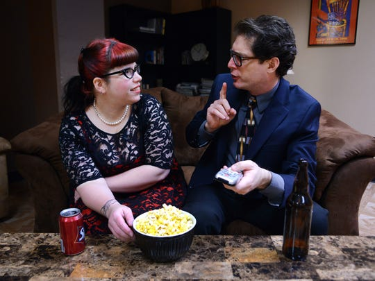 Tom Mayhall Rastrelli, shushing Carlee Wright, takes his Oscars parties seriously.