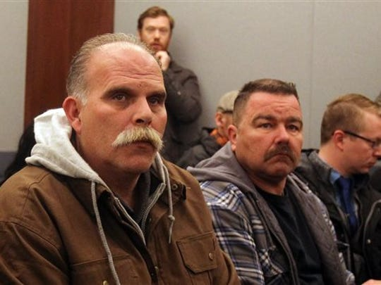 Robert Meyers, left, the widower of Tammy Meyers, attends a hearing for his wife's accused killer, Erich Nowsch Jr. in court Monday, Feb. 23, 2015, in Las Vegas. Nowsch remains jailed following his arrest Friday on murder, attempted murder and other charges in the Feb. 12 shooting that fatally wounded 44-year-old Tammy Meyers outside her home. (AP Photo/Isaac Brekken)