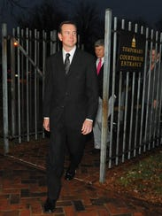 Kurt Busch leaves Family Court in Dover, trailed by