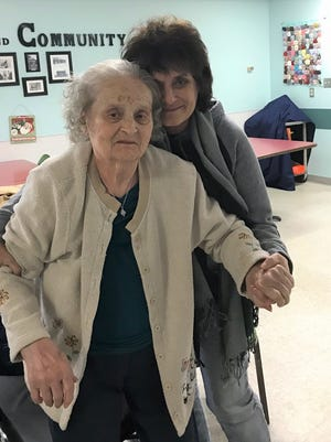 FLORIDA TODAY columnist Britt Kennerly visits with her mother, Helen, at a Kentucky nursing home.