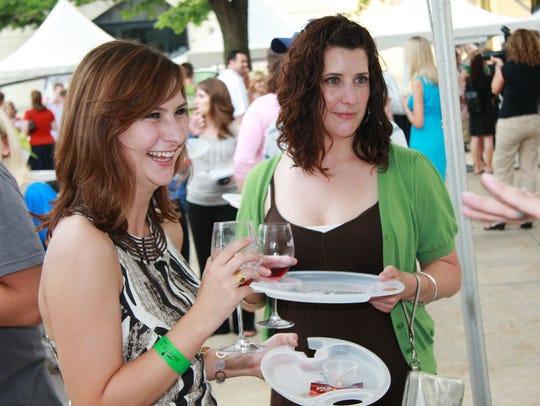 Sisters Katie Halsne, 22, of Woodward, and Julie Halsne,