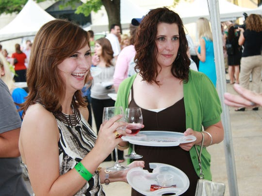 Sisters Katie Halsne, 22, of Woodward, and Julie Halsne, 30, at Sips in the City.