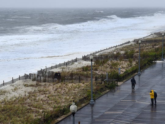 High tide at Rehoboth Beach had water up to the dune