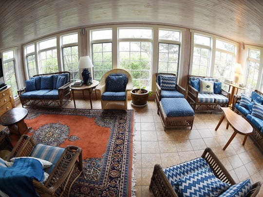 The sunroom of an oceanfront rental home on Stockley