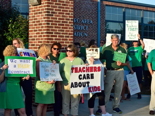 Chambersburg Area Education Association, a teacher's union, carry signs outside the Chambersburg Area School District meeting on Tuesday evening, September 26, 2017. CAEA, currently without a contract, held the rally prior to the CASD meeting.