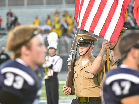 Navy Junior ROTC present the flag during the National