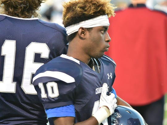 Chambersburg's Tyaire Durant honors the flag during