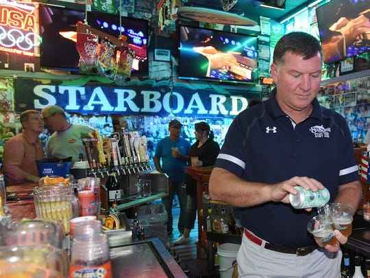 "Steve ""Monty"" Montgomery co-owner of the Starboard in Dewey Beach works the bar and crowd at his establishment along Coastal Highway and Saulsbury Street. Special to the News Journal / CHUCK SNYDER"