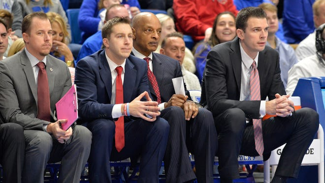 From left, Louisville assistant coaches Michael Bowden, Greg Paulus, Trent Johnson and interim head coach David Padgett watch the action during the first half of their game, Friday, Dec. 29, 2017 in Lexington Ky. Kentucky won 90-61.