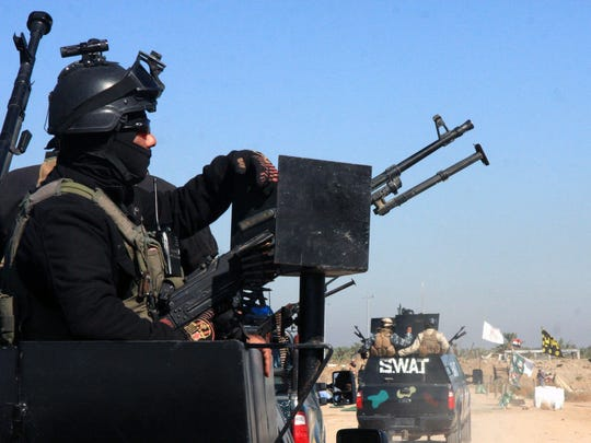 Iraqi military forces take up position at Jurf al-Sakher,