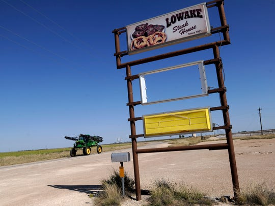 A cotton sprayer drives past the old location of the Lowake Steak House on FM 1929 Thursday Oct. 26, 2017. The restaurant moved to Rowena in February.