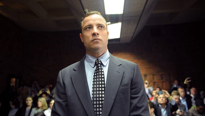 Photo taken on June 4, 2013, shows South African amputee and sprinter Oscar Pistorius appearing at Magistrate Court in Pretoria for the first time since being freed on bail in February over the Valentine's Day killing of his model girlfriend. 7615