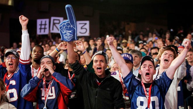 New York Giants fans cheer in the first round of the NFL football draft at Radio City Music Hall, Thursday, April 26, 2012, in New York.