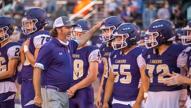 Camdenton football coach Jeff Shore greets players on the sideline during a game against Parkview on September 11.