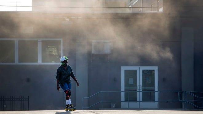 Ebony Nolan skates at a parking lot in Clintonville