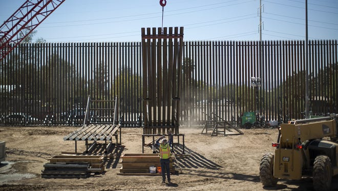 Construction work is carried out where a section of the U.S.-Mexico border wall is being upgraded on April 18, 2018, in Calexico, Calif. Department of Homeland Security Secretary Kirstjen M. Nielsen made a visit to the construction site.