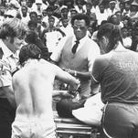 The first victim pulled from the pond is placed on a stretcher and given oxygen before being placed in an ambulance. Kansas City Chiefs running back Joe Delaney, the AFC's 1981 rookie of the year, drowned while trying to save two boys at Chennault Park in Monroe on June 29, 1983.