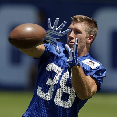 Colts running back Tyler Varga makes a catch as the