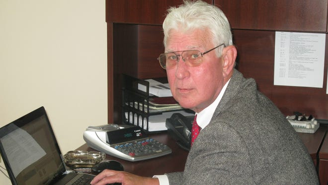 Dan O'Brien works at his private investigation business in this 2012 file photo.